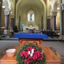 The sanctuary at St. Francis of Assisi is decorated for Christmas.