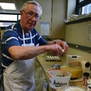 Wayne Dohse cracks eggs for the KC pancake breakfast.